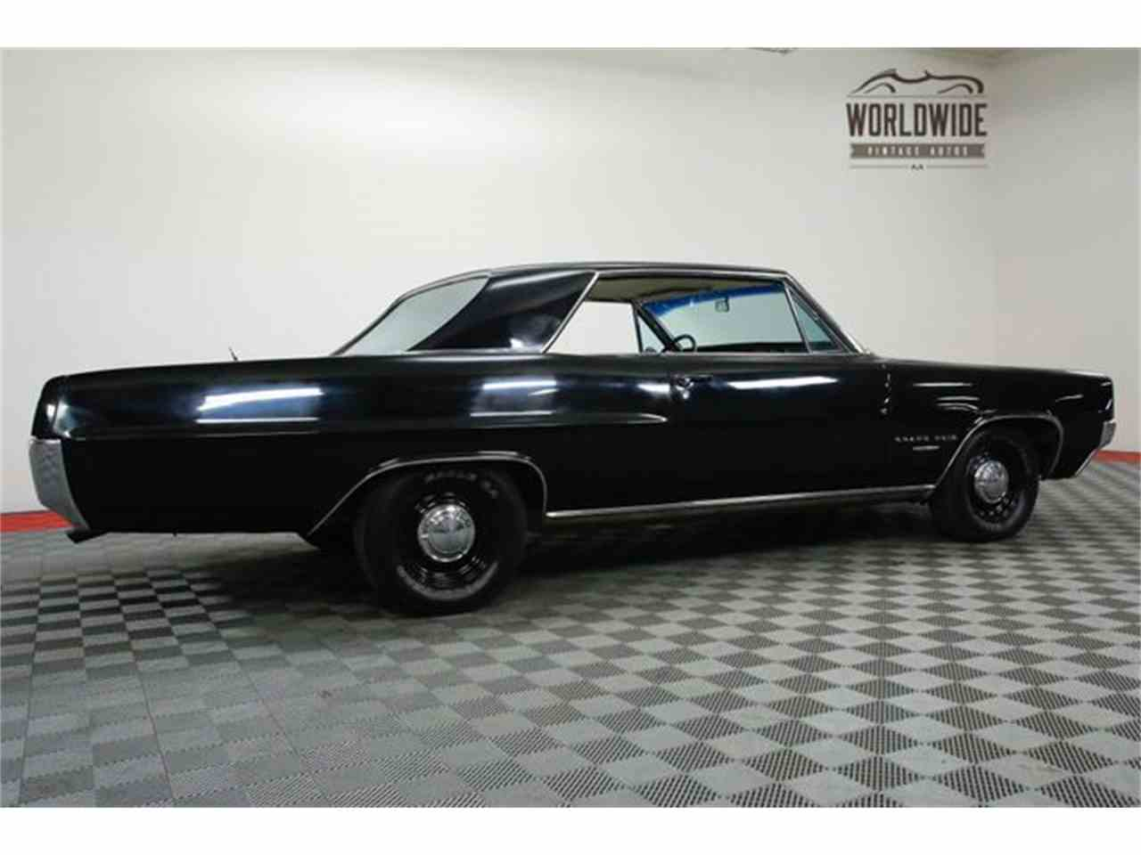 Large Picture of Classic '64 Pontiac Grand Prix located in Colorado Offered by Worldwide Vintage Autos - MGJE