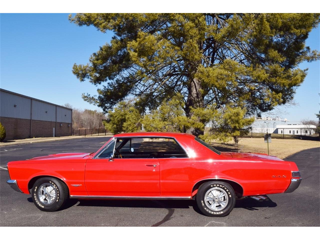 Large Picture of 1965 Pontiac GTO - $57,900.00 Offered by Classic Car Center - MSVJ