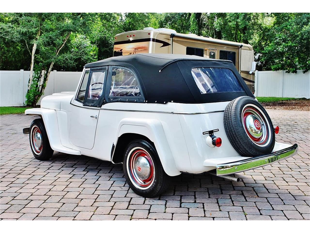 Large Picture of Classic 1950 Willys Jeepster Offered by Primo Classic International LLC - O7F5