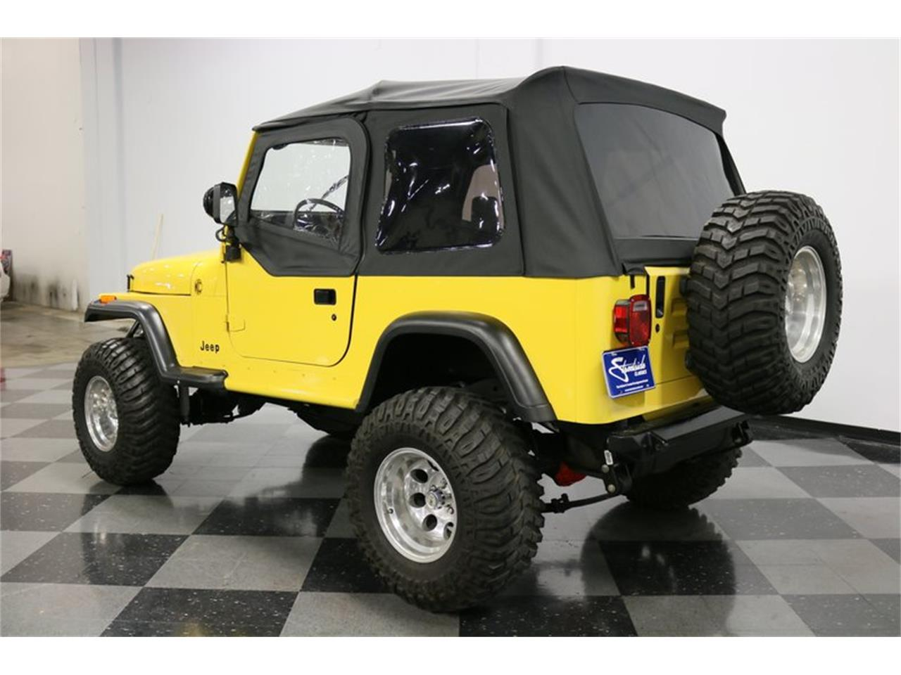 Large Picture of '93 Jeep Wrangler located in Texas - $21,995.00 Offered by Streetside Classics - Dallas / Fort Worth - P701