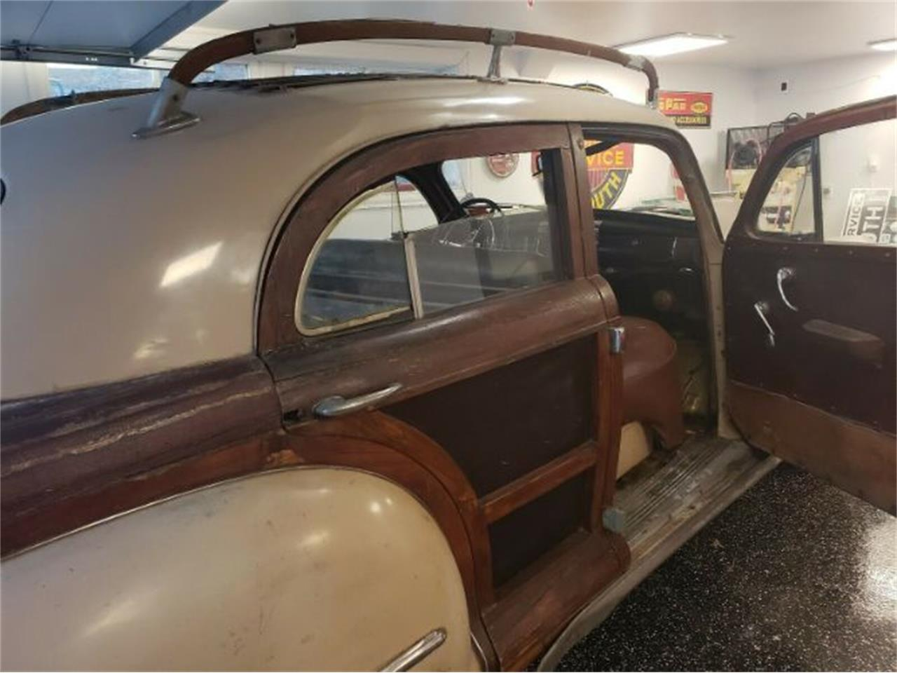 Large Picture of Classic '47 Chrysler Town & Country located in Cadillac Michigan Offered by Classic Car Deals - PJJB