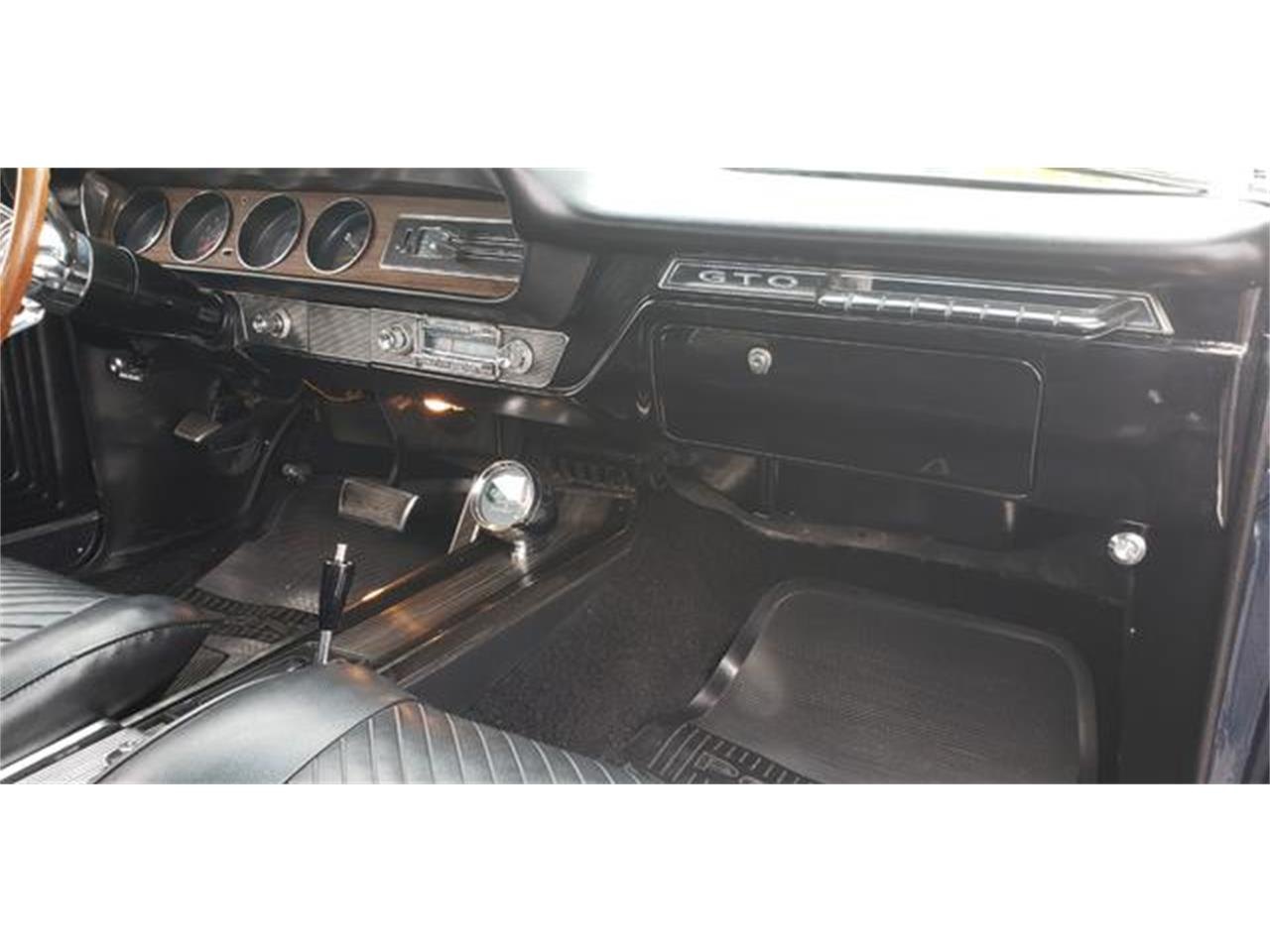 Large Picture of '65 GTO located in Maryland - $32,500.00 Offered by Universal Auto Sales - QFCL