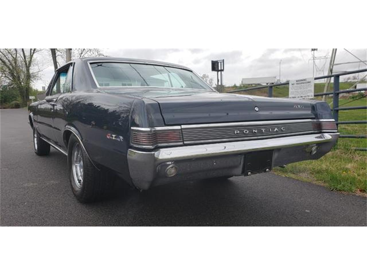 Large Picture of Classic 1965 Pontiac GTO Offered by Universal Auto Sales - QFCL