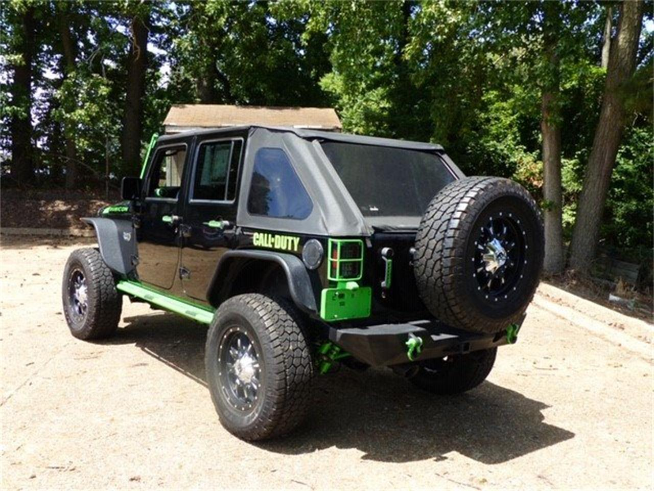 Large Picture of '12 Jeep Wrangler located in North Carolina Offered by GAA Classic Cars Auctions - QJGO