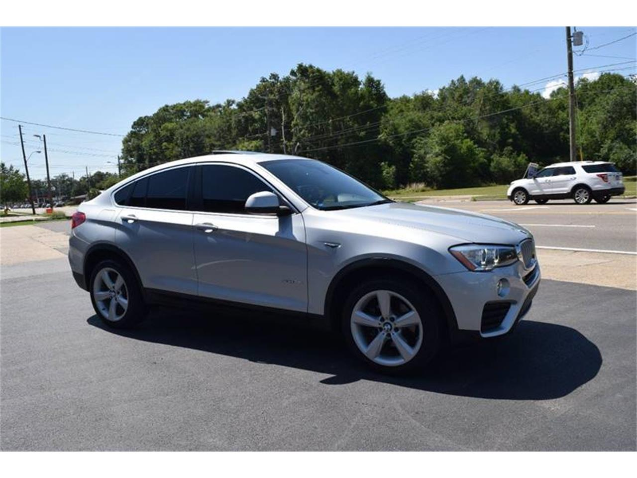 Large Picture of '16 BMW X4 located in Biloxi Mississippi Offered by Gulf Coast Exotic Auto - QKEO