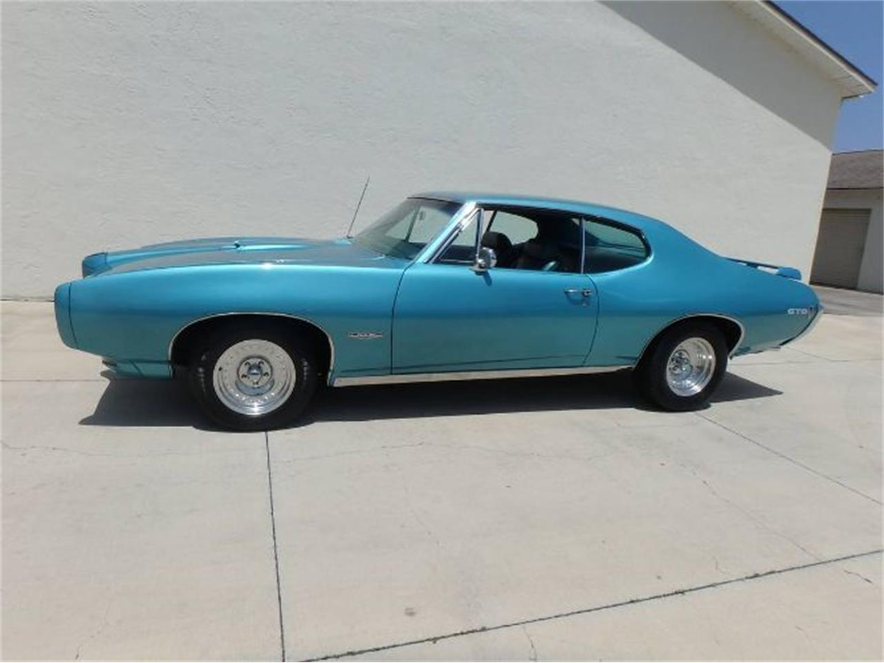 Large Picture of '68 Pontiac GTO located in Michigan Offered by Classic Car Deals - QZRL