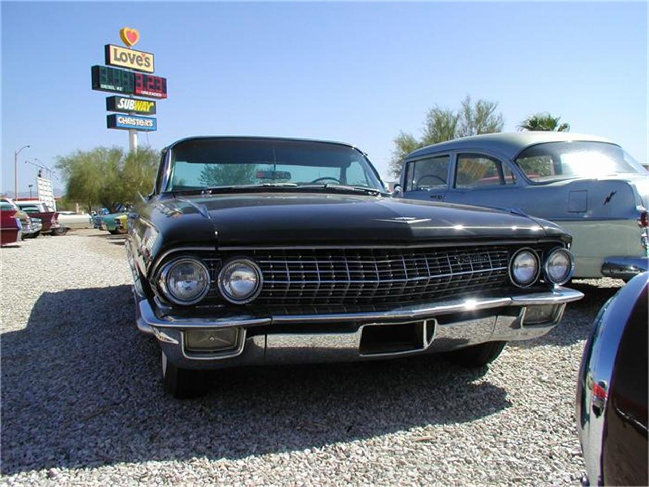 Large Picture of Classic '61 Cadillac 4-Dr Sedan located in Quartzsite Arizona - $29,980.00 Offered by Desert Gardens Classic Cars - 97OS