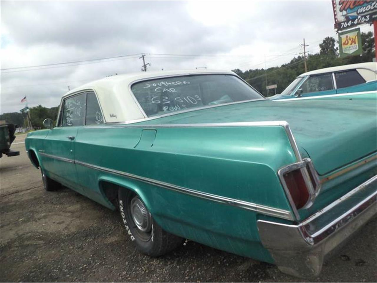 Large Picture of '63 Oldsmobile 88 located in Jackson Michigan Offered by Marshall Motors - EY47