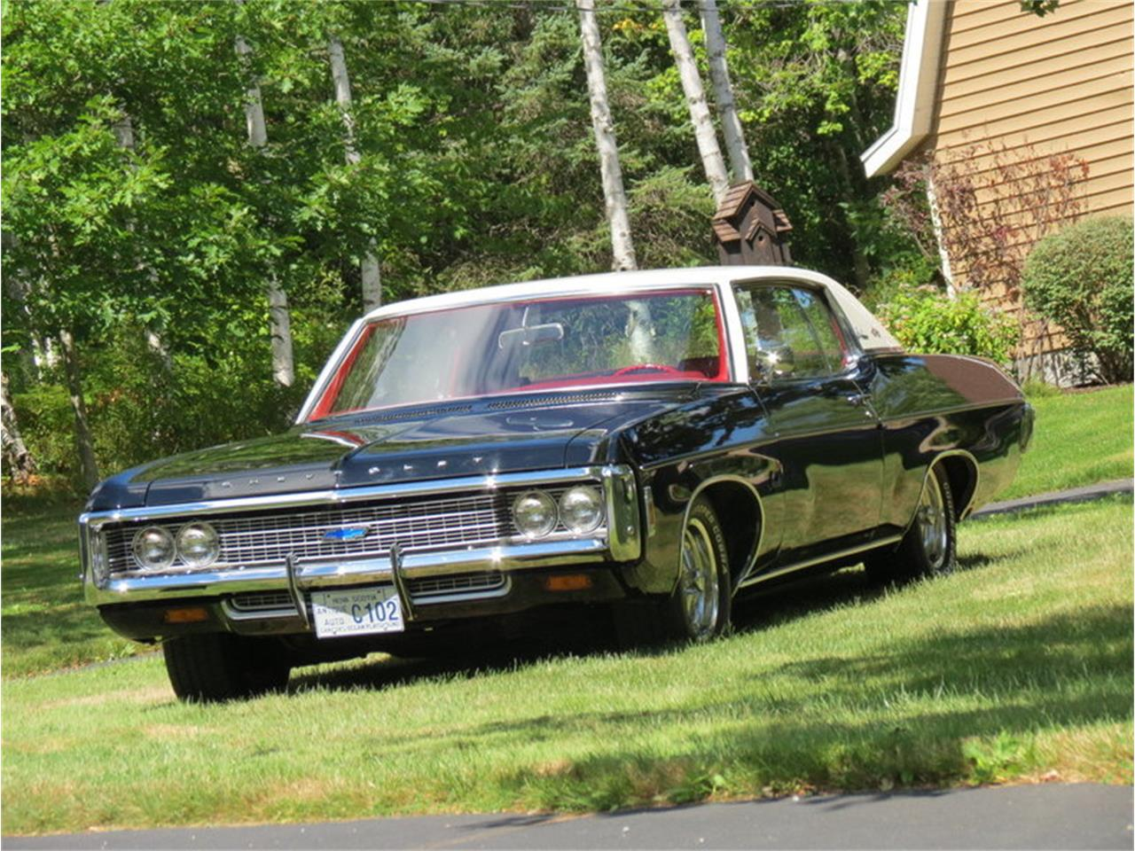 Large Picture of '69 Impala located in Massachusetts Offered by Silverstone Motorcars - JALU