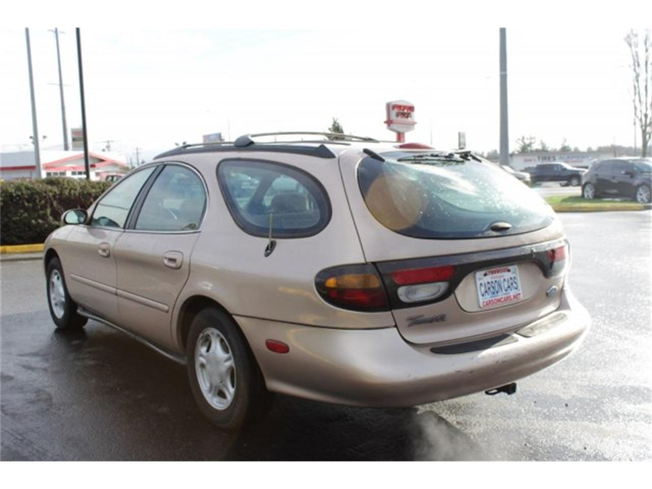 Large Picture of '96 Ford Taurus located in Lynnwood Washington Offered by Carson Cars - JJGX