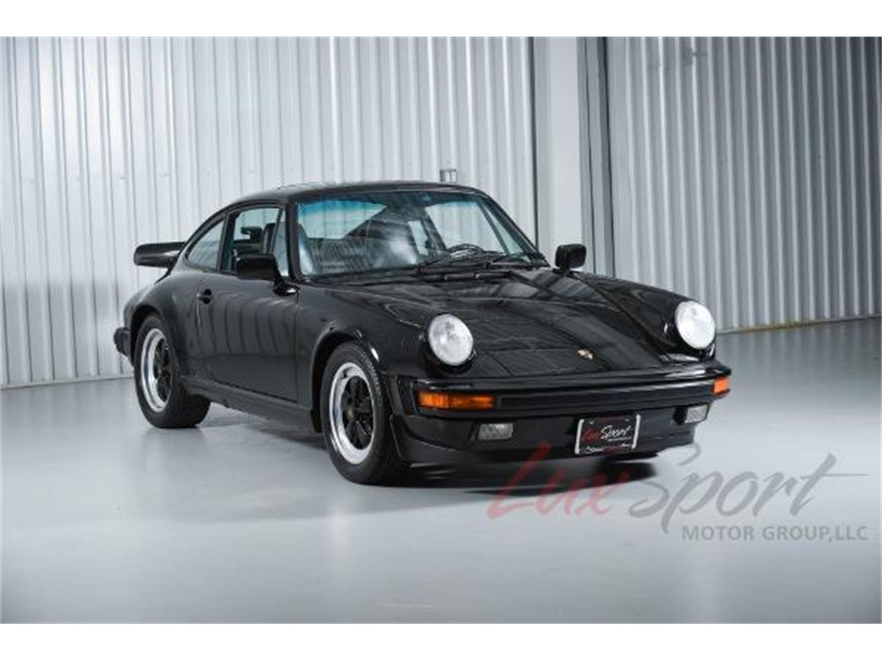Large Picture of 1987 Porsche 911 Carrera located in New Hyde Park New York Offered by LuxSport Motor Group, LLC - JIKQ