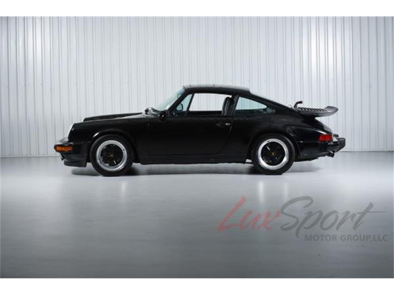 Large Picture of 1987 Porsche 911 Carrera located in New Hyde Park New York Auction Vehicle Offered by LuxSport Motor Group, LLC - JIKQ